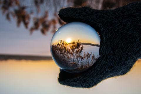 A landscape through a globe lens