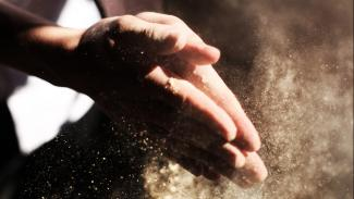 Photo of praying hands getting dirty